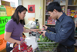 Customer buying food at an oriental food stall,
