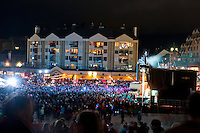 Thousands of people gather in Whistler Village to cheer on the lighting of the cauldron in Whistler Village as the first event of the 2010 Olympic Winter Games.