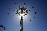 Riders take to the sky on Vertigo, one of the  midway attractions at the Spring Fair in Puyallup, Washington.<br />