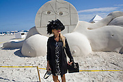 LADY IN HAT; RAQUEL WATTERS; Sand sculpture behind by OLAF BREUNING.  Collectors Brunch, Sagamore Hotel Miami Beach. Art Basel Miami Beach. 6 December 2008 *** Local Caption *** -DO NOT ARCHIVE -Copyright Photograph by Dafydd Jones. 248 Clapham Rd. London SW9 0PZ. Tel 0207 820 0771. www.dafjones.com