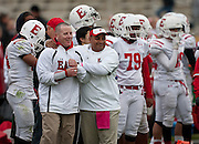 East High School coaches John Chynoweth, left, celebrates during the second half of the East High School vs. Mountain View High School football game at Mountain View High School in Orem, Tuesday, Oct. 23, 2012.