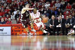 "05 January 2008: Keith ""Boo"" Richardson beats Bryan Mullins and turns the attack towards the lane. The Redbirds of Illinois State took the bite out of the Salukis of Southern Illinois winning the Conference home opener for the 'birds on Doug Collins Court in Redbird Arena in Normal Illinois by a score of 56-47."
