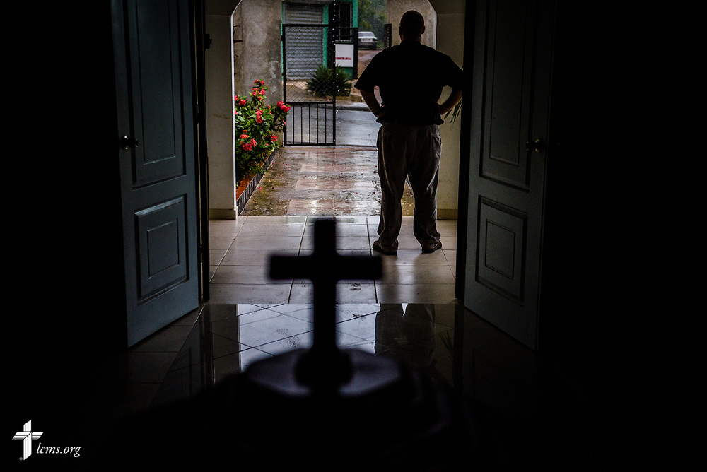 The Rev. Joel Fritsche, LCMS missionary to the Dominican Republic, looks out the entrance of his parish, Amigos de Cristo Iglesia Luterana in Las Americas (Friends of Christ Lutheran Church in the Americas), on Saturday, March 18, 2017, in Santo Domingo. LCMS Communications/Erik M. Lunsford