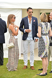 MILLIE MACKINTOSH and HUGO TAYLOR at the Cartier Queen's Cup Final 2016 held at Guards Polo Club, Smiths Lawn, Windsor Great Park, Egham, Surry on 11th June 2016.