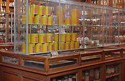 Cabinets displaying samples, including some from China in yellow tins, in the Musee Francois Tillequin – Collections de Matiere medicale, featuring laboratory collections of plants or parts of plants or animals used for medicinal purposes, at the former Ecole de Pharmacie de Paris, now the Faculte de Pharmacie at the Universite Paris Descartes, on the Avenue de l'Observatoire in the 6th arrondissement of Paris, France. The 25,000 samples were collected in the 18th, 19th and 20th centuries and the museum was opened in 1882. Picture by Manuel Cohen
