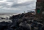 Roma 22  Febbraio 2010.Idroscalo di Ostia,una della case che sarà abbattuta dalle  ruspe comune di Roma,i detriti sugli scogli  portati dalle mareggiate