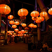 Hanging Chinese lanterns illuminate the walkway at Tivoli Gardens in Copenhagen, one of the oldest amusement parks in the world
