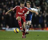 Photo: Jonathan Butler.<br />Blackburn Rovers v Liverpool. The Barclays Premiership. 26/12/2006.<br />Steven Gerrard of Liverpool fends off Morten Gamst Pedersen of Blackburn.