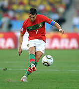 CRISTIANO RONALDO (Portugal) takes a free kick during the 2010 FIFA World Cup South Africa Group G match between Portugal and Brazil at Durban Stadium on June 25, 2010 in Durban, South Africa.