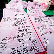Guests sign register and give red envelopes at a traditional taiwanese wedding in Namasiya Township, Kaoshiung County, Taiwan