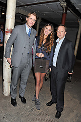Left to right, BEN & MARY-CLARE ELLIOT and GEORDIE GRIEG at a party to celebrate the launch of the new Vertu Constellation phone - the luxury phonemakers first touchscreen handset, held at the Farmiloe Building, St.John Street, Clarkenwell, London on 24th November 2011.