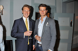 Left to right, JAMES TUSSAUD and TOM WARREN at a evening with fashion label Lilah held at Quo Vadis, 26-29 Dean Street, London W1 on 29th May 2013.