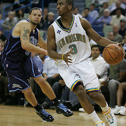New Orleans Hornets guard Chris Paul #3 drives around Utah Jazz guard Deron Williams #8 in the fourth quarter of their NBA game on April 8, 2008 at the New Orleans Arena in New Orleans, Louisiana. The Utah Jazz defeated the New Orleans Hornets 77-66.