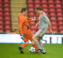 LIVERPOOL, ENGLAND - Thursday, May 14, 2009: Nick Peat of the Liverpool Echo beats Radio Merseyside's Gary Flintoff to the ball during a match before the Hillsborough Memorial Charity Game at Anfield. (Photo by David Rawcliffe/Propaganda)