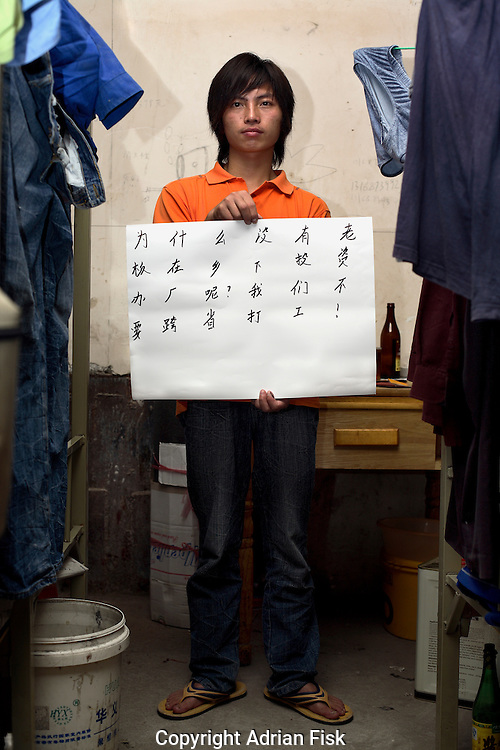 Feng Long - 21 Yrs.<br /> First time migrant labourer working on new building interiors.<br /> Shanghai.<br /> <br /> 'Why aren't there any companies setting up factories in the countryside? We don't want to work as migrant labourers'.