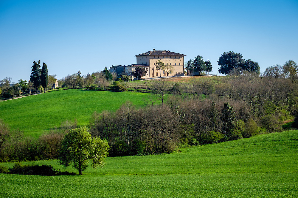 MONTERIGGIONI, ITALY - CIRCA MAY 2015:  House over the hills near San Gimignano in Tuscany