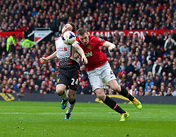 16.03.2014, Old Trafford, Manchester, ENG, Premier League, Manchester United vs FC Liverpool, 30. Runde, im Bild Liverpool's Joe Allen is pushed over by Manchester United's Phil Jones for, second penalty // during the English Premier League 30th round match between Manchester United and Liverpool FC at Old Trafford in Manchester, Great Britain on 2014/03/16. EXPA Pictures © 2014, PhotoCredit: EXPA/ Propagandaphoto/ David Rawcliffe<br /> <br /> *****ATTENTION - OUT of ENG, GBR*****