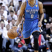 19 June 2012: Oklahoma City Thunder point guard Russell Westbrook (0) yells at his teammates as he brings the ball upcourt during the first quarter of Game 4 of the 2012 NBA Finals, Thunder at Heat, at the AmericanAirlinesArena, Miami, Florida, USA.
