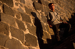 TURKEY DIYARBAKIR JUL02 - Portrait of young Kurdish boy on Diyarbakir's old city wall...jre/Photo by Jiri Rezac..© Jiri Rezac 2002..Contact: +44 (0) 7050 110 417.Mobile:  +44 (0) 7801 337 683.Office:  +44 (0) 20 8968 9635..Email:   jiri@jirirezac.com.Web:     www.jirirezac.com
