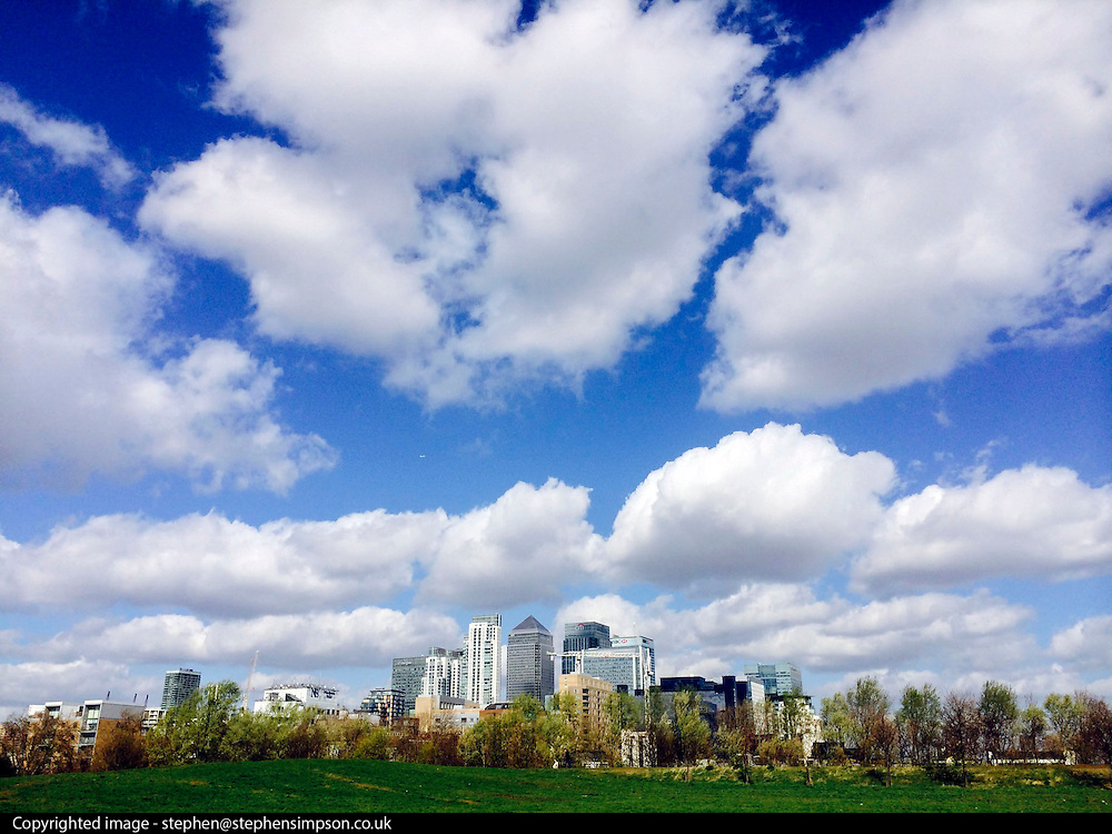 © Licensed to London News Pictures. 21/03/2014. LONDON, UK Clouds form above the buildings of Canary Wharf in the background today 21 March 2014. Photo credit : Stephen Simpson/LNP