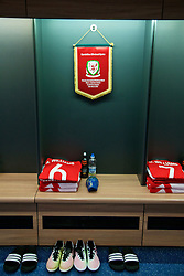 CARDIFF, WALES - Thursday, March 24, 2016: Wales' captain Ashley Williams' shirt, boots and match pennant in the dressing room before the International Friendly match against Northern Ireland at the Cardiff City Stadium. (Pic by David Rawcliffe/Propaganda)