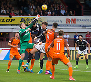 August 9th 2017, Dens Park, Dundee, Scotland; Scottish League Cup Second Round; Dundee versus Dundee United; Dundee United's Harry Lewis punches the ball clear under pressure from Dundee's Marcus Haber and Jack Hendry