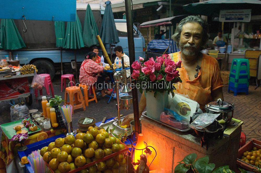 Fruit juice stall at market by the river. Bangkok.
