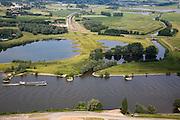 Nederland, Gelderland, Kandia, 28-06-2006; Betuweroute in Oostelijke richting, Neder-Rijn (Pannerdensch kanaal) in de voorgrond, met binnenvaartschip, daarachter beschermd natuurgebied Kandia (met zeldzame padden oorspronkelijk zou hier een brug komen maar om het natuurreservaat en stiltegebied te ontzien is er een tunnel geboord; boortunnel, Betuwelijn, democratie, inspraak, rivierdijk, landschap, milieu, transport, verkeer en vervoer, planologie, geluidsoverlast, spoorbrug; zie ook (lucht)foto's van deze lokatie; deel van de serie Panorama Nederland luchtfoto (toeslag aerial photo (additional fee required .foto Siebe Swart / photo Siebe Swart