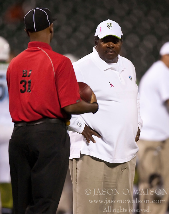 October 17, 2009; San Francisco, CA, USA;  California Redwoods head coach Dennis Green talks with an offical during the second quarter against the New York Sentinels at AT&T Park. California won 24-7.