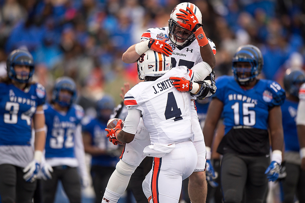 Auburn's Chandler Cox (27) and Jason Smith (4) celebrate after Smith caught an 11-yard touchdown pass from Jeremy Johnson to take the lead in the third quarter. <br /> Auburn Tigers vs. Memphis Tigers in the Birmingham Bowl at Legion Field in Birmingham, Ala. on Wednesday, Dec. 30, 2015.<br /> Zach Bland/Auburn Athletics