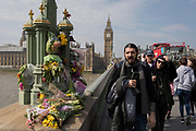 One week after the terrorist attack in the UK capital, Londoners and visitors to Britain pay their respects to the scene where flower memorials are left on Westminster Bridge (where pedestrians were mown down by a car) and outside the Palace of Westminster where armed police now guard the location where a police officer was killed, on 28th March 2017, London, England. (Photo by Richard Baker / In Pictures via Getty Images)