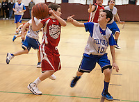 Ryan Dee of the Lou Athanas Laconia gets around of Gilford's Korey Weston during the senior boys round of the annual Francoeur/Babcock Tournament Friday evening.   (Karen Bobotas/for the Laconia Daily Sun)