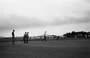 17/9/1970<br /> 9/17/1970<br /> 17 September 1970<br /> <br /> Peter Oosterhuis from Dulwich & Sydenham walking over to his ball as Bert Yancey puts his ball toward the hole
