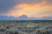 Sunset through storm clouds over the Teton Range,  Grand Teton National Park, Wyoming