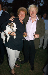 BORIS JOHNSON MP and ANN SINDALL at a party to celebrate the publication of Notting Hell by Rachel Johnson held in the gardens of 1 Rosmead Road, London W11 on 4th September 2006.<br />