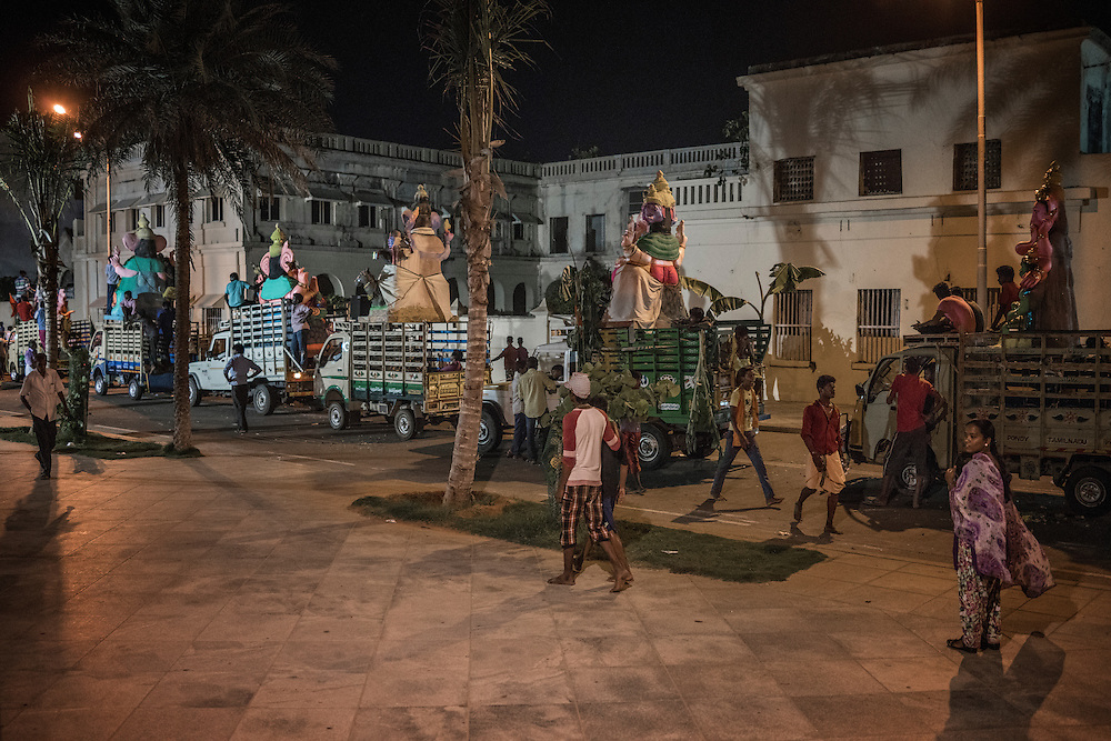Lord Ganesha statues from local villages have been loaded onto the back of trucks and driven to the Pondicherry waterfront where a crane will lower them into the sea and symbolically into the sea.  Pondicherry, India.