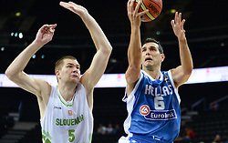 Uros Slokar of Slovenia vs Nikalaos Zisis of Greece during friendly match between National Teams of Slovenia and Greece before World Championship Spain 2014 on August 17, 2014 in Kaunas, Lithuania. Photo by Robertas Dackus / Sportida.com