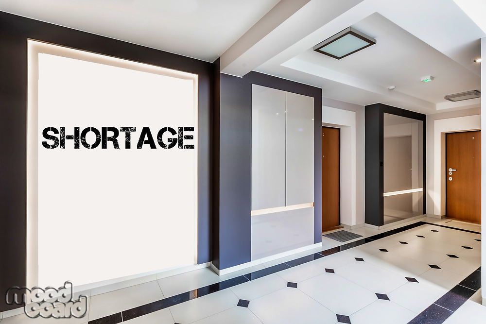 Photo of rental apartment business interior with shortage sign on the wall