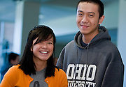 OU senior Yee Wong, left, continues a family tradition by spending time with her brother, Yiu Sing Leung during sibs weekend eventhough her brother is now a OU freshman. photo by Kevin Riddell