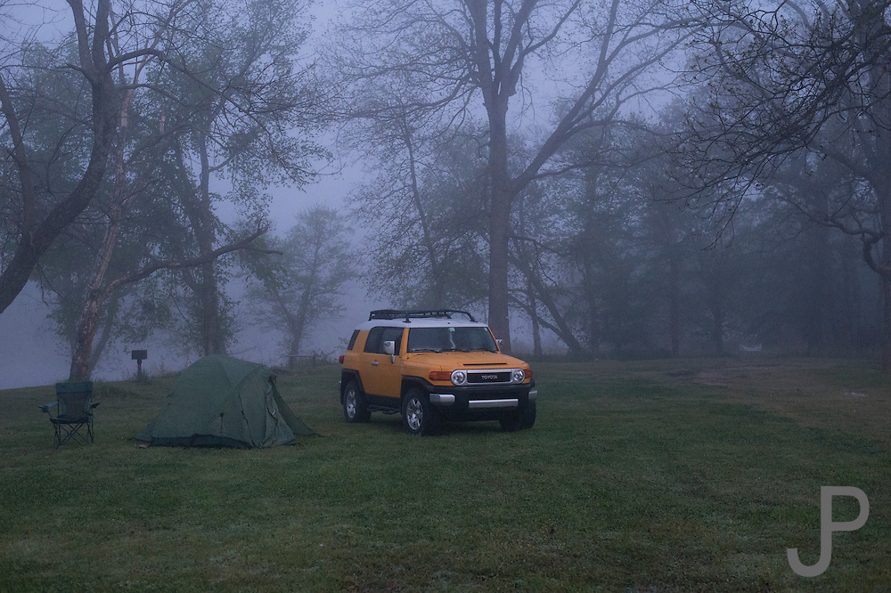 Sparrowhawk Campground - Tahlequah, OK. James Pratt camps beside the Illinois River with his Toyota FJ Cruiser.
