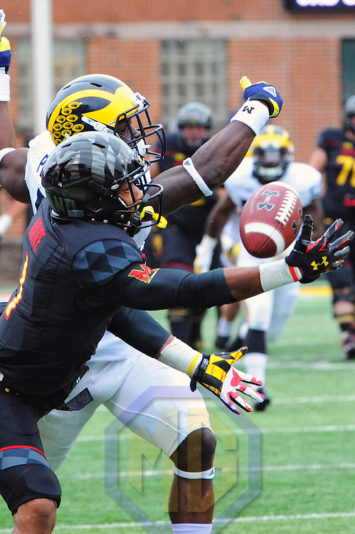03 October 2015:   Maryland Terrapins wide receiver D.J. Moore (1) cannot hang on to a pass as he is defended by Michigan Wolverines safety Jabrill Peppers (5) at Byrd Stadium in College Park, MD. where the Michigan Wolverines defeated the Maryland Terrapins, 28-0 for their second consecutive shut out. (Photograph by Mark Goldman/Goldminephotos)