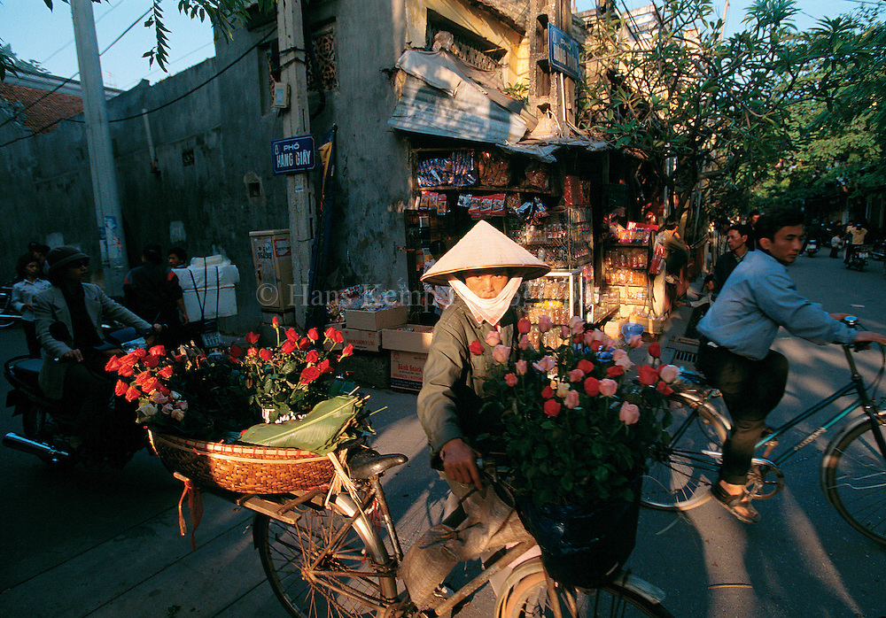 A woman sells flowers on Hang buom Street in the Old Quarter of Hanoi.