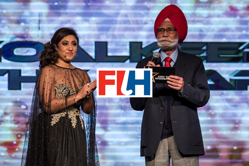 CHANDIGARH, INDIA - FEBRUARY 23: Balbir Singh [R], Three Time Olympic Gold Medalist accompanied by compere Sanchalli Arora speaks during the FIH Hockey Stars Awards 2016 at Lalit Hotel on February 23, 2017 in Chandigarh, India. (Photo by Ali Bharmal/Getty Images for FIH)
