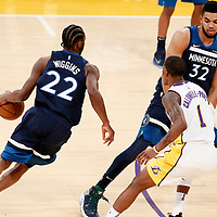 25 December 2017: Minnesota Timberwolves forward Andrew Wiggins (22) drives past Los Angeles Lakers guard Kentavious Caldwell-Pope (1) on a screen set by Minnesota Timberwolves center Karl-Anthony Towns (32) during the Minnesota Timberwolves 121-104 victory over the LA Lakers, at the Staples Center, Los Angeles, California, USA.