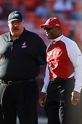 October 10, 2010; San Francisco, CA, USA;  Philadelphia Eagles head coach Andy Reid (left) meets with San Francisco 49ers head coach Mike Singletary (right) before the game at Candlestick Park.