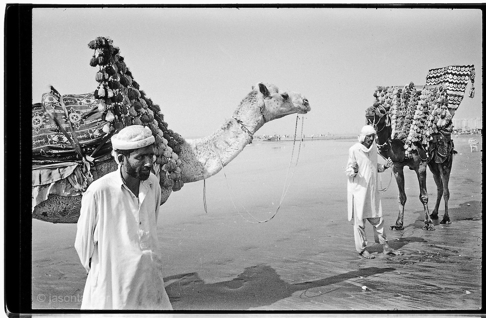 Karachi: Camel owners wait for visitors on Clifton Beach.