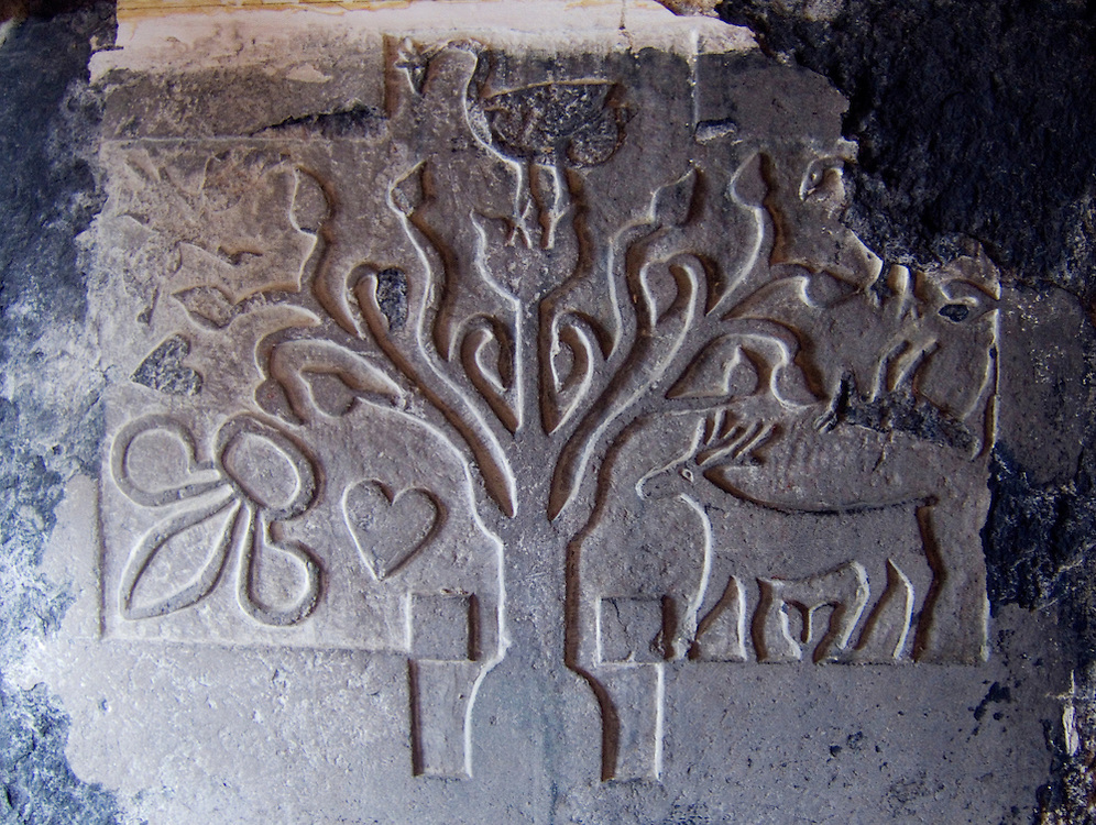 Old carved grave slab inside the Protestant St. Columba's Parish Church at Drumcliff, County Sligo, Ireland.