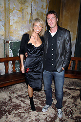 Tennis player MARAT SAFIN and ANASTASIA RAGOZINA at the Stephen Webster launch party of his latest jewellery collection during the London Jewellery Week, at Wilton's Music Hall, Graces Alley, Off Ensign Street, London E1 on 12th June 2008.<br />
