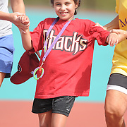 Alexa Villarreal runs the bases Saturday September 13, 2014 during the opening weekend of The Miracle League. (Jason A. Frizzelle)