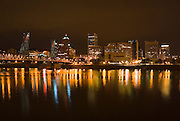 Portland skyline at night reflected in the Willamette River, Portland, Oregon